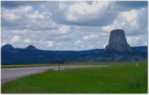 Looking West: Devil's Tower (and the Missouri Buttes, on the left) formed from volcanic activity underground millions of years ago. Local uplift and the erosion of the softer sediments surrounding the Tower of granite led to its exposure.